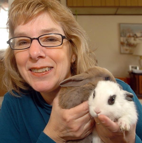 Rose Ann Goins with two rescued rabbits