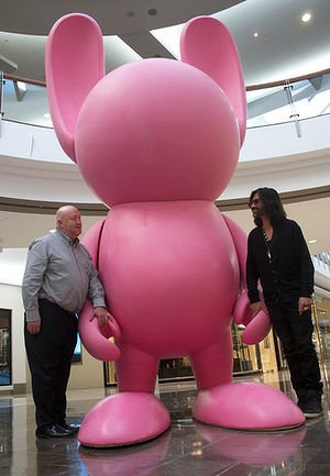 Brisbane Festival artistic director Noel Staunton and artist Stormie Mills are dwarfed by the giant bunny sculpture that will be installed in Brisbane. Photo credit: Vicki Winter / Brisbane Times.